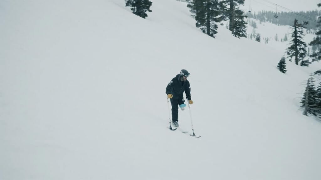 Adaptive Athlete Phil Quintana mono-skiing at Squaw Valley Alpine Meadows