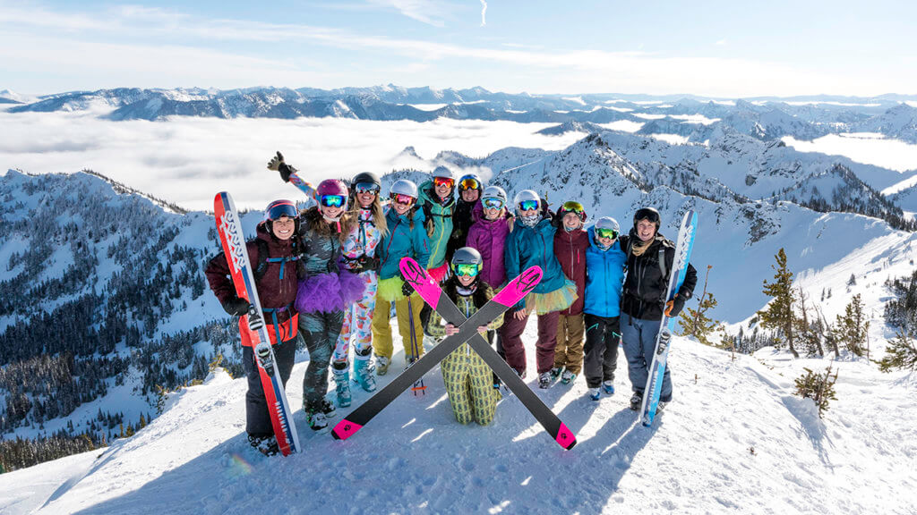 Group of women in ski gear at the top of the mountain at Crystal Ski Resort.