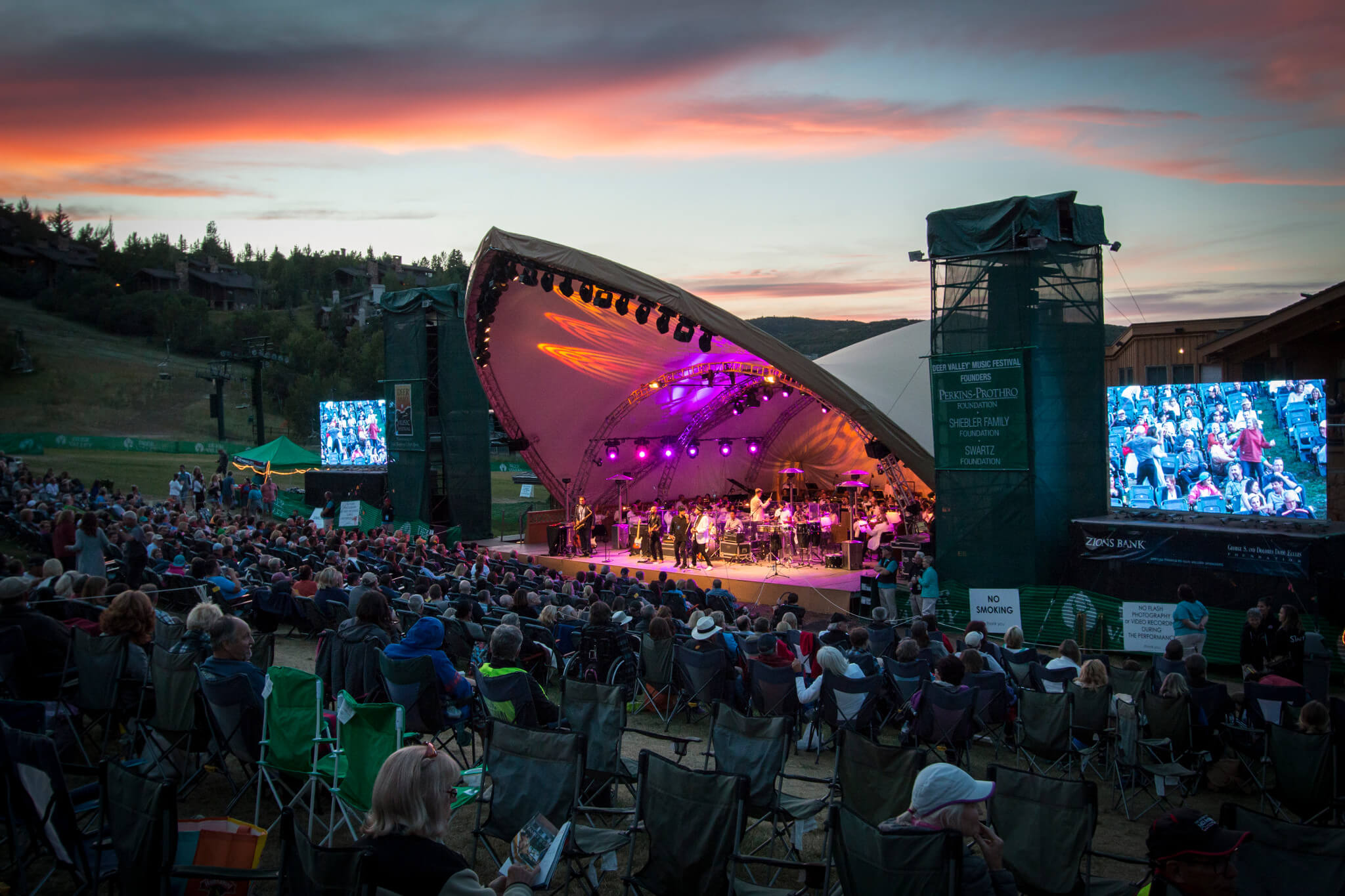 Crowd of people watching a concert at dusk at Deer Valley Resort